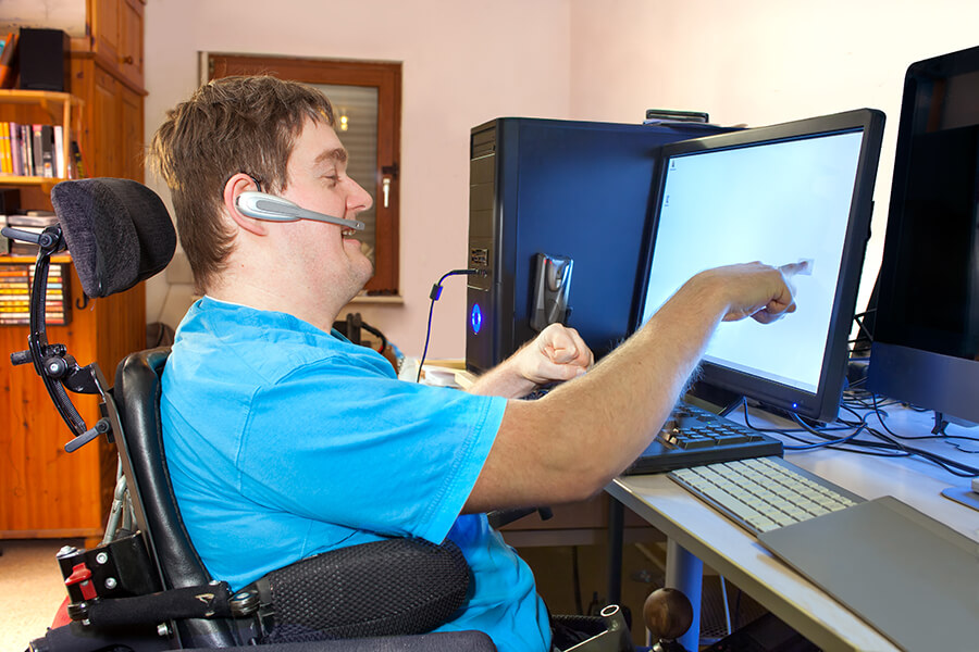Young man with a disability using a computer