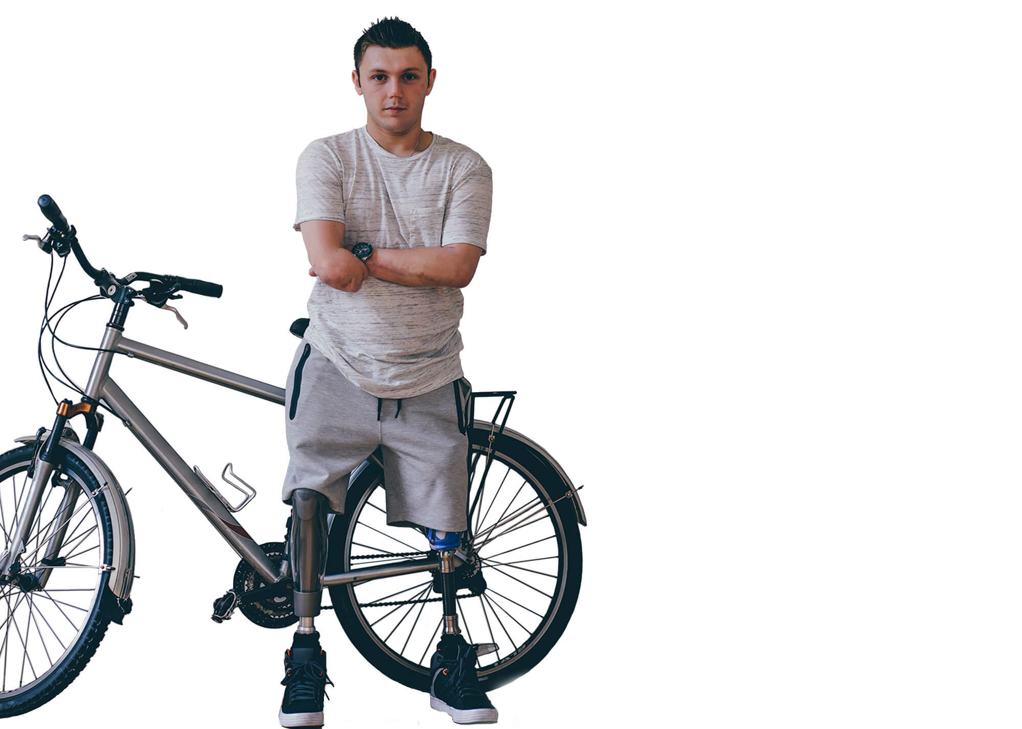 man with 2 artificial legs leaning on a bike