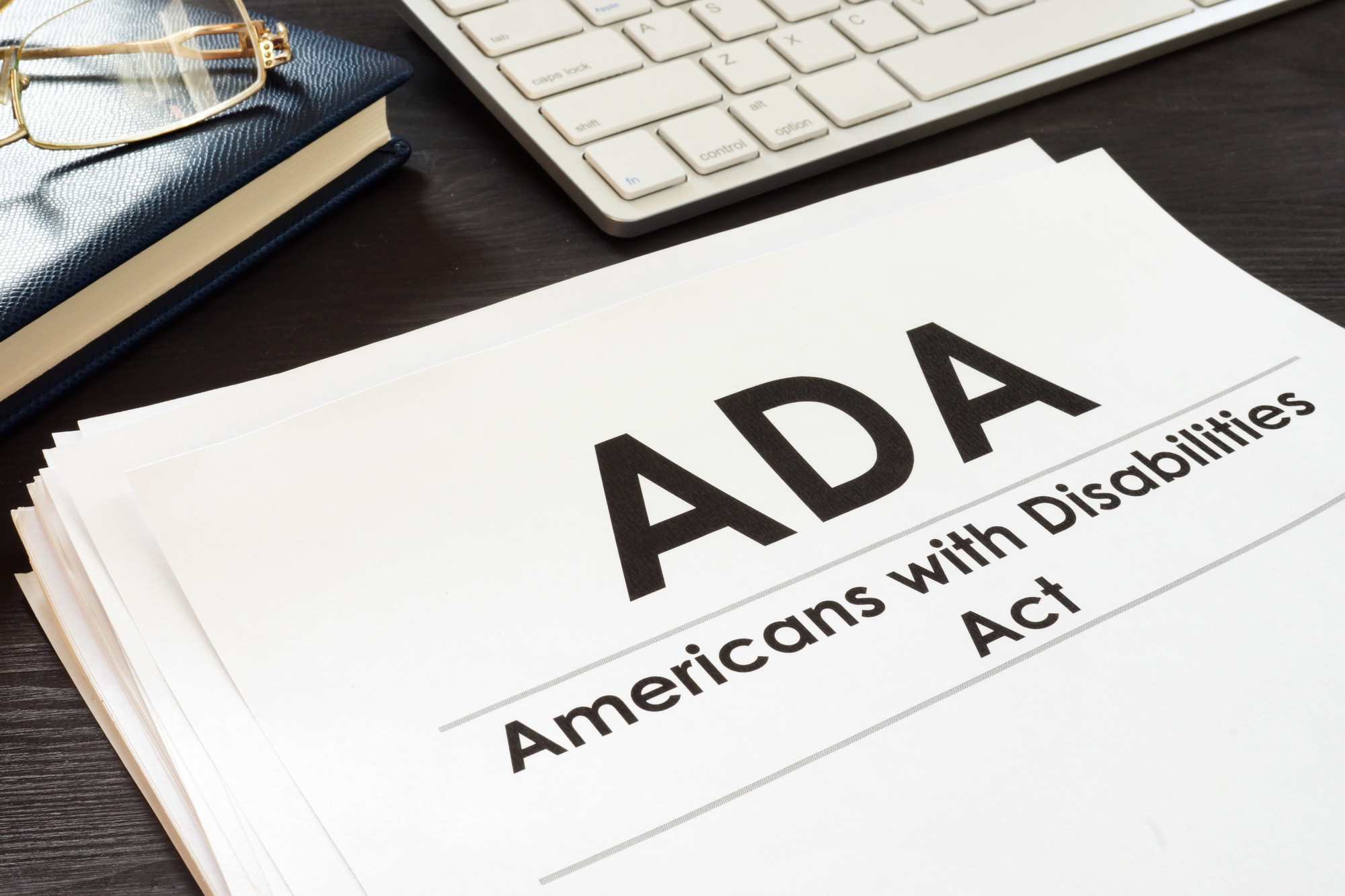 papers with ADA Americans with Disabilities Act on the front